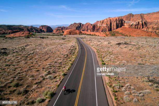 An aerial view of age group triathletes biking through Snow Canyon during the IRONMAN 70.3 St George Utah on May 5, 2018 in St George, Utah.