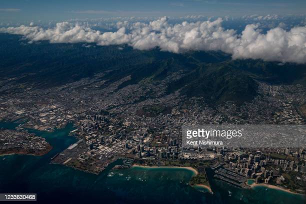 An aerial view of Ala Moana Beach Pack and Honolulu from a United Airlines flight out of Los Angeles International Airport flying over the island of...