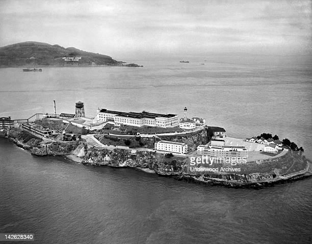 An aerial view of Alcatraz Island and prison in San Francisco Bay San Francisco California 1946 Angel Island is behind it with a 'Welcome Home Well...
