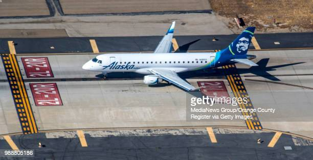 An aerial view of an Alaska Airlines jet waiting to takeoff from John Wayne Airport in Santa Ana on Thursday June 28 2018