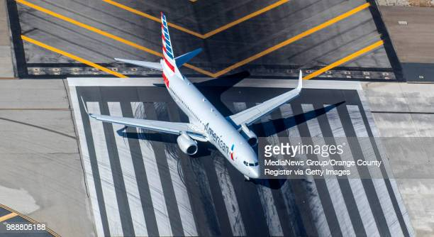 An aerial view of an American Airlines jet preparing to takeoff from John Wayne Airport in Santa Ana on Thursday June 28 2018