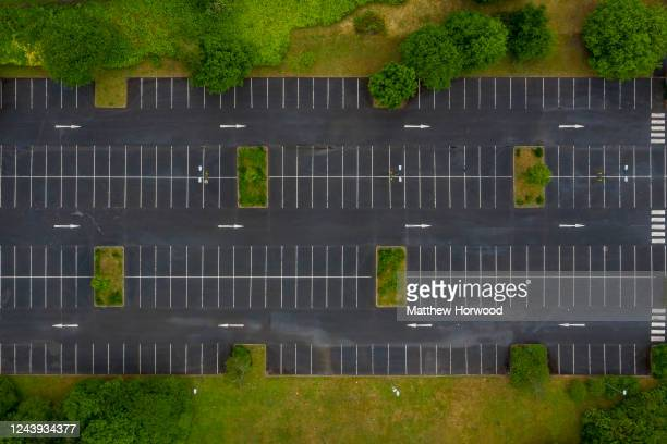 An aerial view of an empty car park at a retail park on June 03, 2020 in Nantgarw, United Kingdom. The Welsh government has further relaxed COVID-19...