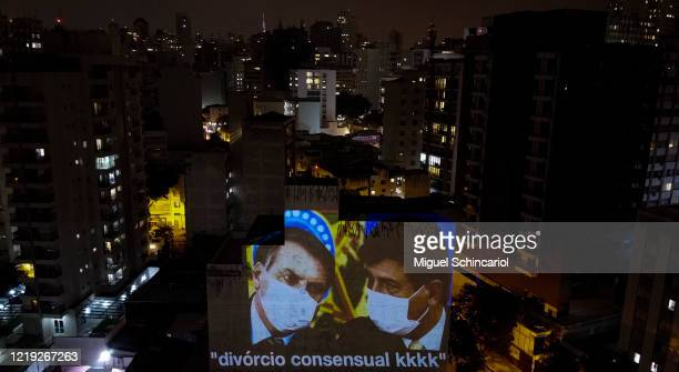 An aerial view of an image of an image of President of Brazil Jair Bolsonaro with outgoing Health Minister Luiz Henrique Mandetta projected on a...