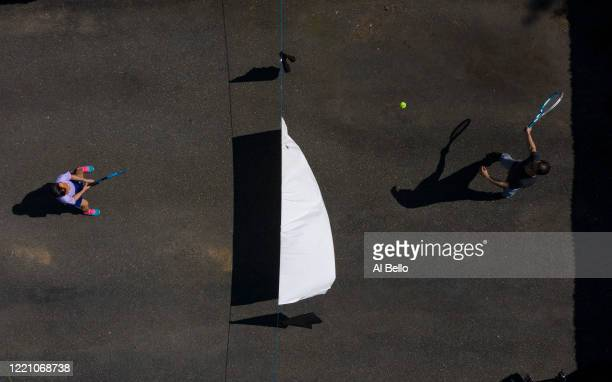An aerial view of Ana Diaz who is a nurse at Northwell Syosset Hospital plays tennis with her Son Mel Diaz who is a Patient Transporter at Northwell...