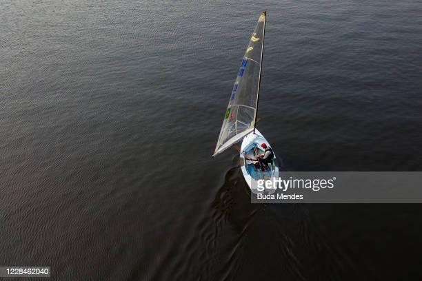 An aerial view of Brazilian sailing athlete Jorge Joao Zarif during a training session at Marina da Gloria amidst the coronavirus pandemic on...