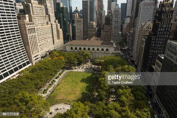 an aerial view of bryant park in new york city - bryant park stock pictures, royalty-free photos & images