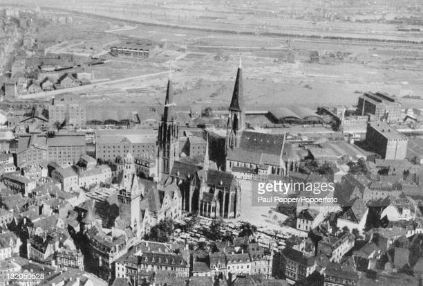 An aerial view of Burgplatz in Duisburg Germany showing the Rathaus Salvator Church and the church of St Ludger circa 1900