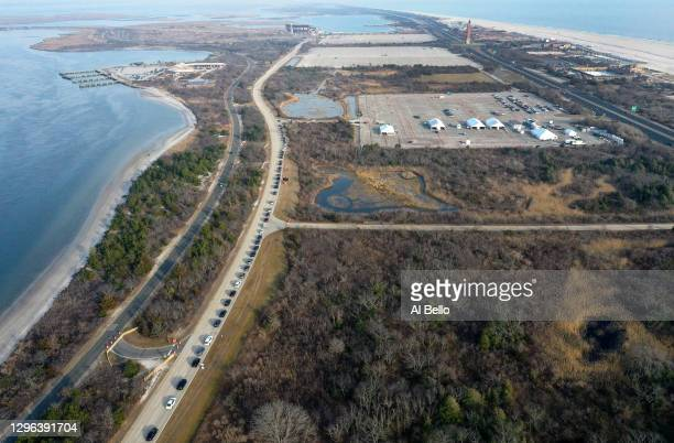 An aerial view of cars lined up along the roadway to get a COVID-19 vaccination as the State of New York opened its third mass vaccination site in...