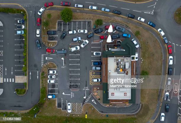 An aerial view of cars queuing for a McDonald's drive-through restaurant on June 03, 2020 in Swansea, United Kingdom. The Welsh government has...
