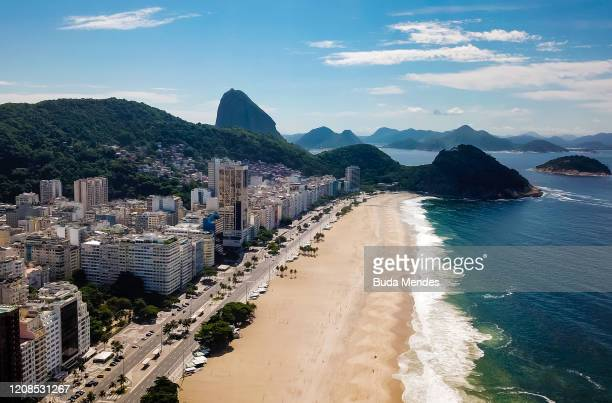 An aerial view of Copacabana beach amidst the coronavirus pandemic on March 29, 2020 in Rio de Janeiro, Brazil. Botafogo beach is usually very busy...