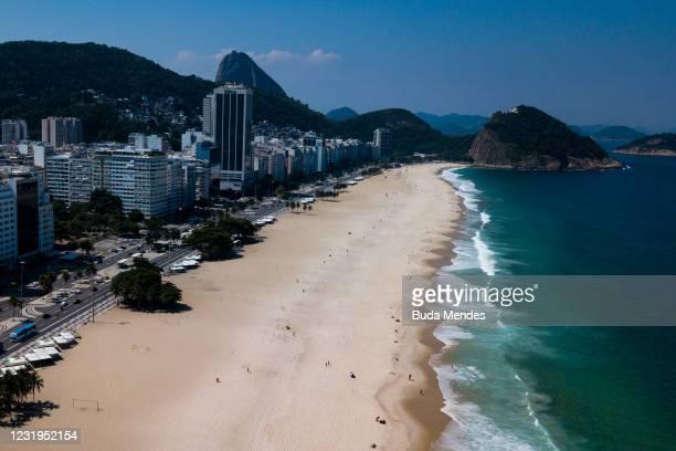 An aerial view of Copacabana beach during a partial lockdown on March 26, 2021 in Rio de Janeiro, Brazil. The state of Rio de Janeiro created an...