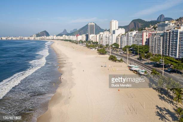 An aerial view of Copacabana beach on March 19, 2020 in Rio de Janeiro, Brazil. Rio de Janeiros state government and city council official recommend...
