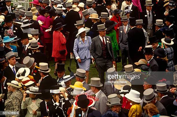 An aerial view of crowds of racegoers on Ladies Day at Royal Ascot racing week Tophatted gentlemen and women in posh frocks gather before the next...
