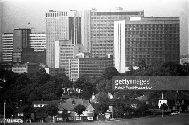 An aerial view of Croydon office buildings with suburban homes in the foreground, circa June 1969. From a series of images to illustrate the many...