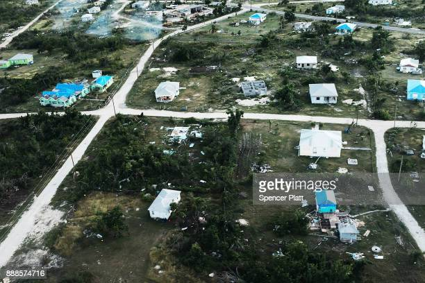 An aerial view of damaged homes on the nearly destroyed island of Barbuda on December 8 2017 in Cordington Barbuda Barbuda which covers only 62...