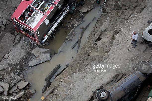 An aerial view of damaged vehicles on the road after gas explosions in southern Kaohsiung on August 1, 2014 in Kaohsiung, Taiwan. A series of...