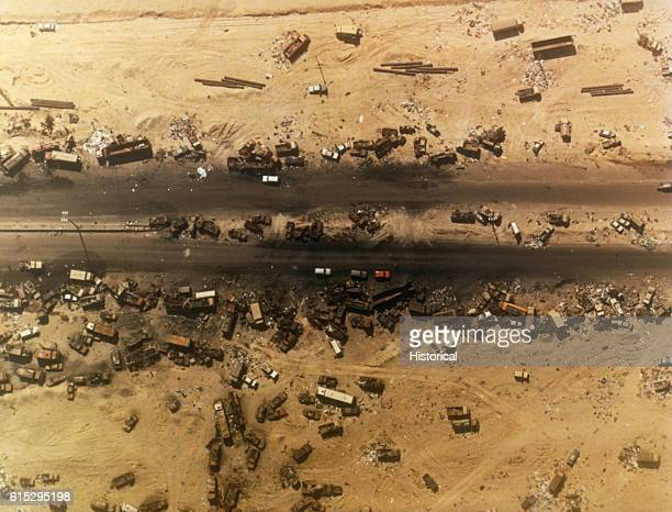 An aerial view of debris flanking the highway west of Kuwait City Dubbed the 'Highway of Doom' the roadway was bombed by coalition forces on February...