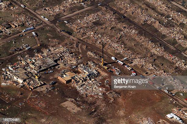 An aerial view of destroyed houses and buildings and the Plaza Towers Elementary School on May 21 2013 in Moore Oklahoma The town reported a tornado...
