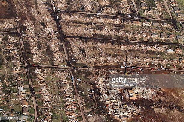 An aerial view of destroyed houses and buildings on May 21 2013 in Moore Oklahoma The town reported a tornado of at least EF4 strength and two miles...
