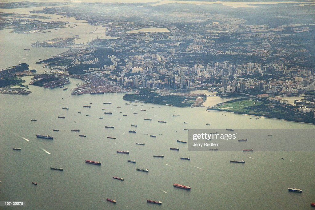 An aerial view of downtown Singapore showing some of the shipping that makes the Singapore Strait one of the busiest shipping lanes in the world..