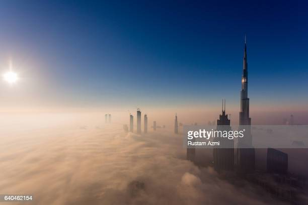 An Aerial view of Dubai Downtown at Sunrise during foggy Morning on December 10 2016 in Dubai United Arab Emirates