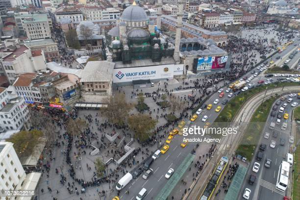An aerial view of Eminonu district as people are queuing up in front of Nimet Abla kiosk the most famous ticket agency in Istanbul to buy lottery...
