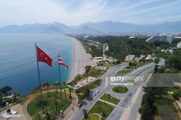An aerial view of empty seaside is seen in Antalya, Turkey on April 18, 2020 during the restrictions which re-imposed in 31 provinces for two days as...