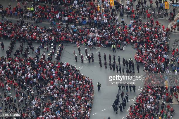 An aerial view of fans and a marching band who gather at Exhibition Place near the Princes Gates as they turn out for the Toronto Raptors NBA...