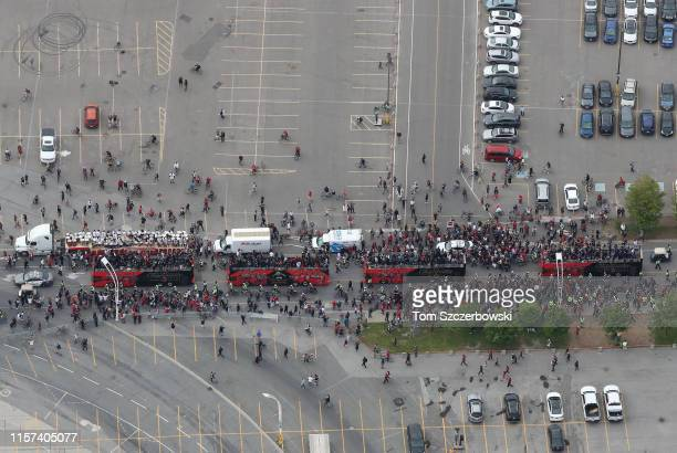An aerial view of fans who gather along Lake Shore Boulevard at Exhibition Place near the Princes Gates as they turn out for the Toronto Raptors NBA...