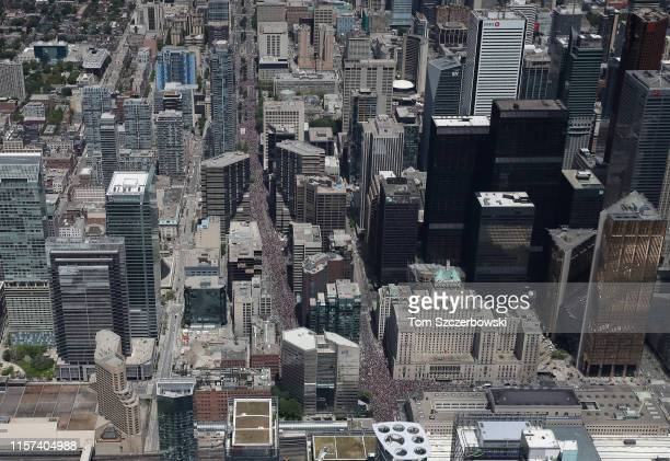 An aerial view of fans who gather along University Avenue and York Street and Front Street near the Fairmont Royal York Hotel as they turn out for...