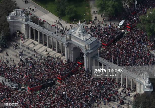 An aerial view of fans who gather at the Princes Gates at Exhibition Place with the Goddess of Winged Victory statue on top of the arch as they turn...