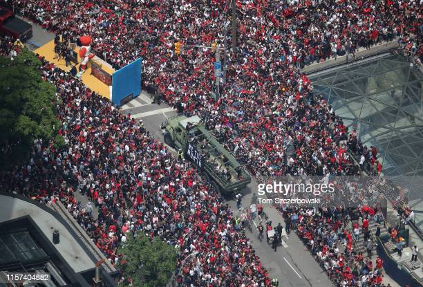 An aerial view of fans who gather on Front Street and York Street and University Avenue as they turn out for the Toronto Raptors NBA Championship...