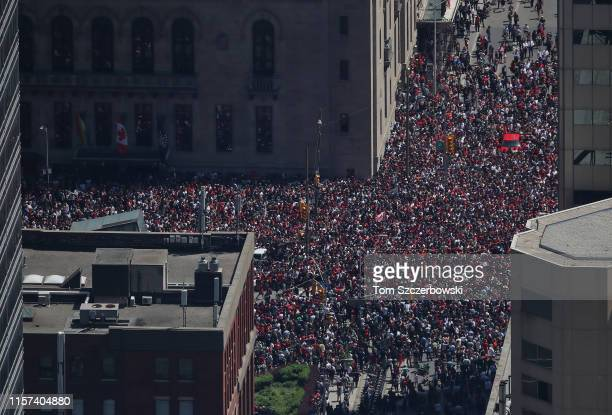An aerial view of fans who gather on York Street and University Avenue as they turn out for the Toronto Raptors NBA Championship Victory Parade after...