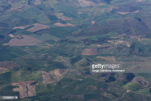 An aerial view of farmland and rolling hills in the province of Viterbo, Italy