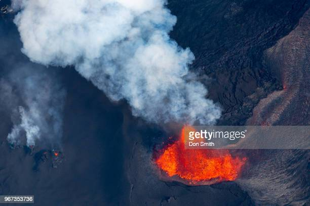 An aerial view of Fissure 8 Fountain which is located inside Leilani Estates spews molten lava on June 1 2018 in Pahoa Hawaii Lava was estimated to...