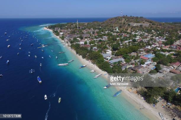 An aerial view of Gili Trawangan island following Sunday's earthquake on August 9 2018 in Lombok Island Indonesia The official death toll has reached...