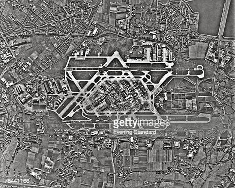 An aerial view of Heathrow Airport terminus and runway and the surrounding area 1st February 1978