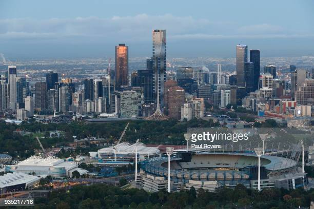 An aerial view of Hisense Arena Rod Laver Arena and the Melbourne Cricket Ground with the Melbourne city skyline on February 13 2018 in Melbourne...