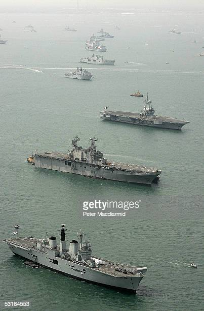 An aerial view of HMS Invincible USS Saipan and FS Charles de Gaulle with some of the 112 warships gathered in the Solent ahead of the International...