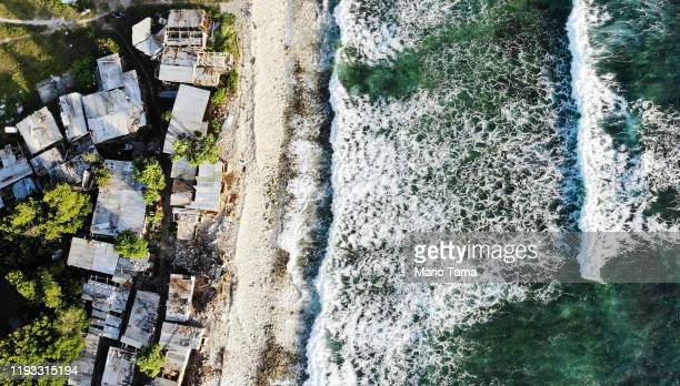 An aerial view of homes next to the Pacific Ocean on November 28 2019 in Funafuti Tuvalu The lowlying South Pacific island nation of about 11000...