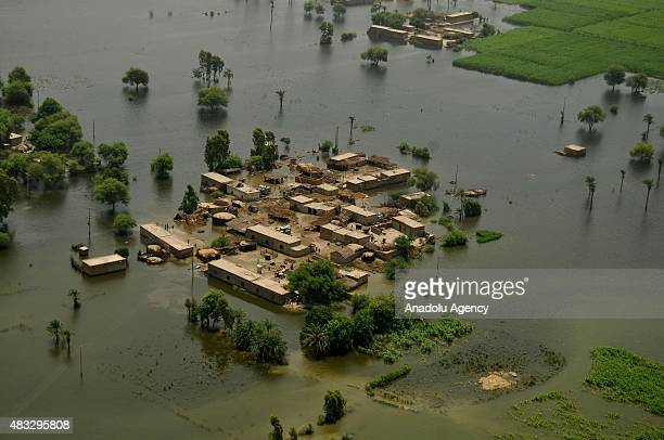 An aerial view of houses inundated with floodwater in Layyah district of Punjab province Pakistan on August 07 2015 Torrential rains and flash floods...