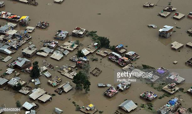 An aerial view of houses submerged in flood waters in Srinagar The floods and landslides from days of heavy monsoon rains have now claimed more than...