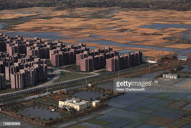 An aerial view of housing estate in Chittagong with surrounding agricultural fields awash with sea water brought in by one of the biggest cyclones to...