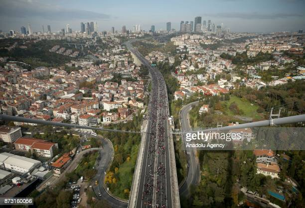 An aerial view of hundreds of participants competing during Vodafone 39th Istanbul Marathon at The 15 July Martyrs Bridge in Istanbul Turkey on...