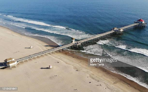 An aerial view of Huntington Beach and its shuttered pier amid the coronavirus pandemic on March 28 2020 in Huntington Beach California The city of...