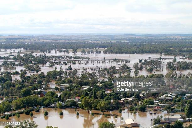 An aerial view of inundated houses on March 7, 2012 in Wagga Wagga, Australia. 9000 evacuated residents are waiting for authorities to survey the...