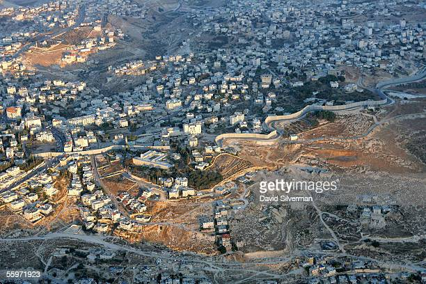 An aerial view of Israel's separation wall October 20 2005 where it divides the Palestinian village of Abu Dis and cuts its residents off from East...