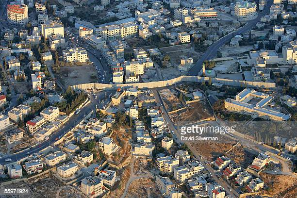An aerial view of Israel's separation wall October 20, 2005 where it divides the Palestinian village of Abu Dis and cuts its residents off from East...