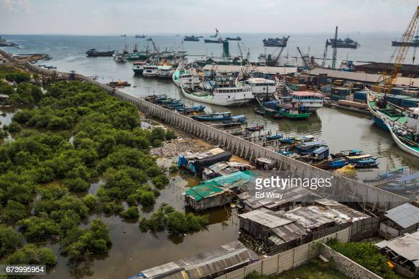 An aerial view of Jakarta's new seawall and land which has been sinking below sea level on April 27 2017 in Jakarta Indonesia Jakarta one of the...