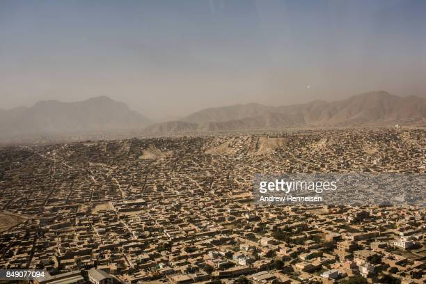 An aerial view of Kabul is seen from a helicopter on September 5 2017 in Kabul Afghanistan Currently the United States has about 11000 troops in the...